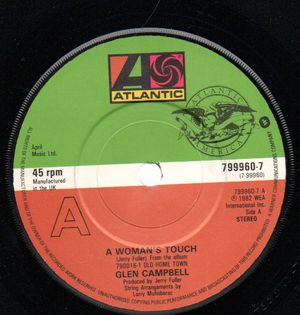 GLEN CAMPBELL, A WOMAN'S TOUCH / HANG ON BABY (EASE MY MIND)